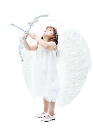 Beautiful little angel at a white background. photo