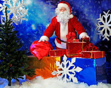 Christmas theme: Santa  gifts, snowy design. Stock Photo - 6139902
