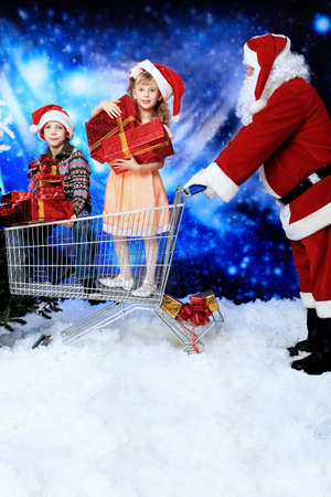 Christmas theme: Santa  gifts, shopping with a child. photo