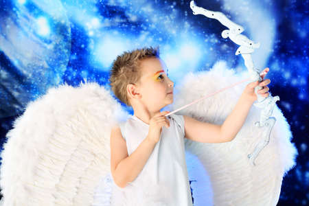 Beautiful little angel at a snowy background. Stock Photo - 6174079
