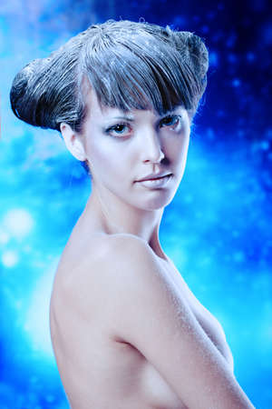 Portrait of a snow female model over sky of stars and snow. Fashion, beauty. photo