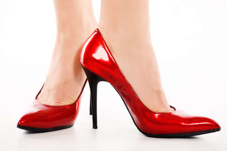 Female legs in elegant red shoes on white background Stock Photo - 6197717