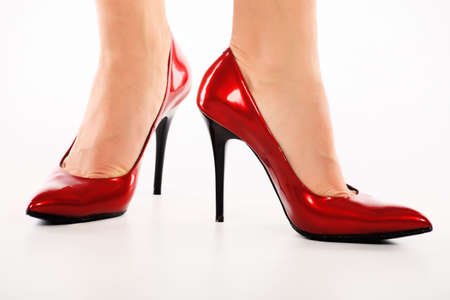 Female legs in elegant red shoes on white background Stock Photo - 6197721