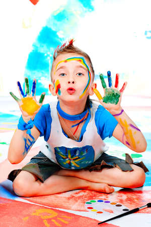 Portrait of a beautiful child enjoying his painting. Education. Stock Photo - 6191558