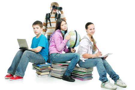 Educational theme: group of emotional teenagers sitting  together on books.  photo