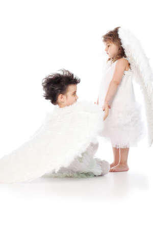 defenceless: Beautiful little angels. Isolated over white background.
