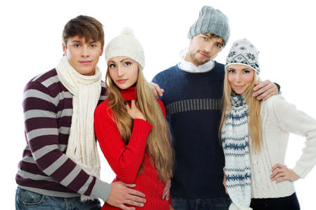 Group of happy young people in warm clothes. photo