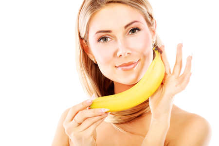 Portrait of a beautiful young woman holding bananas. photo
