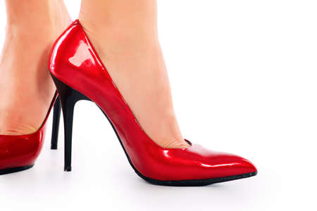 Female legs in elegant red shoes on white background Stock Photo - 6251064