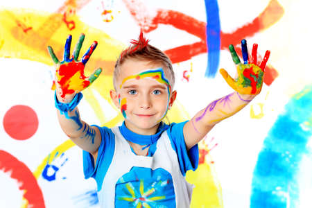 Portrait of a beautiful child enjoying his painting. Education. Stock Photo - 6247777