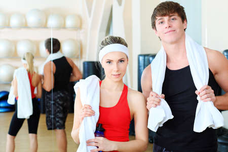 Couple of a sporty young people in the gym centre. Stock Photo - 6247779