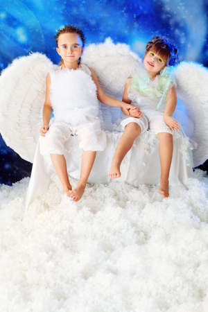 Beautiful little angels at a snowy background. Stock Photo - 6247768