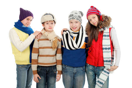 Group of teenagers in warm clothes standing together. photo