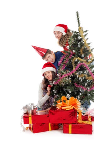 Group of happy teenagers celebrating christmas together. photo