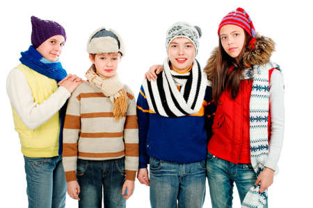 Group of teenagers in warm clothes. photo