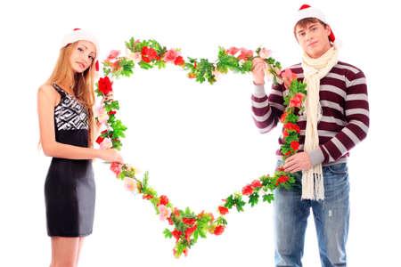 Couple of young people celebrating christmas. photo