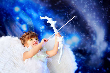 baby hairstyle: Beautiful little angel at a snowy background.