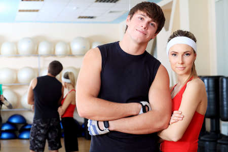 Couple of a sporty young people in the gym centre. photo