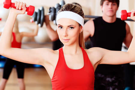 muscular body: Couple of a sporty young people in the gym centre. Stock Photo