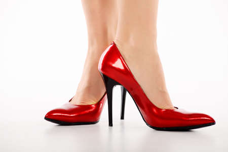 Female legs in elegant red shoes on white background Stock Photo - 6301539