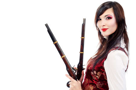 Portrait of the elegant young woman in 19th century costume holding guns in her hands. Shot in a studio. Stock Photo - 6299934