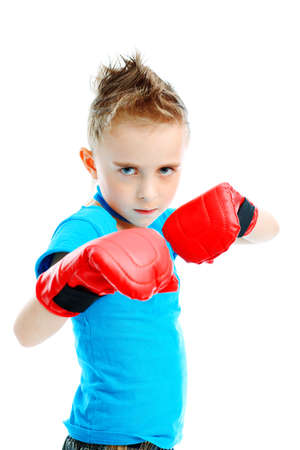 boxing boy: Portrait of a cute sporty boy in boxing gloves. Isolated over white background. Stock Photo