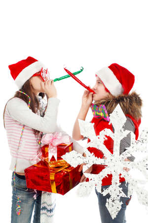Two happy girls teenagers celebrating christmas together. Stock Photo - 6347146