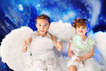 Beautiful little angels at a snowy background. Stock Photo - 6347138