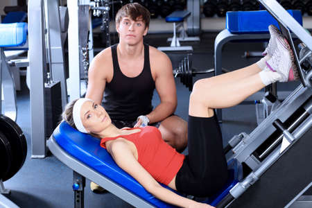 Couple of a sporty young people in the gym.  Stock Photo - 6347150