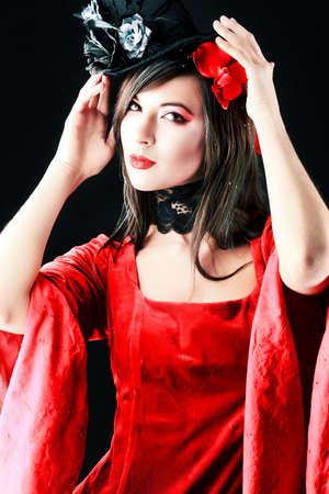 Portrait of a beautiful woman in medieval era dress. Shot in a studio. Stock Photo - 6353105