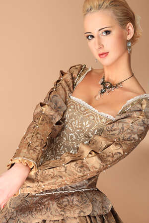 costume ball: Portrait of a beautiful woman in medieval era dress. Shot in a studio. Stock Photo