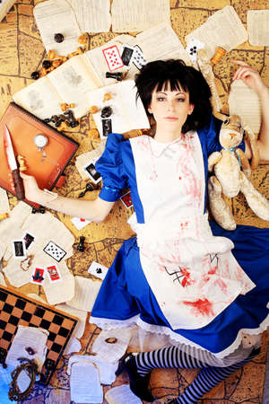 Portrait of a young woman dressed as Alice in Wonderland, video game.