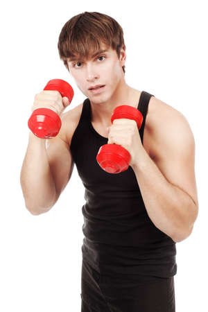 Sporty young man with dumbbells in his hands. photo