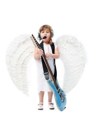 Beautiful little angel with a guitar at a white background. photo