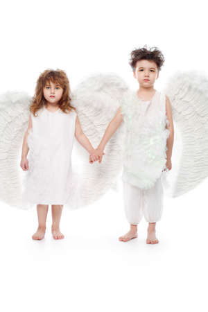 Beautiful little angels. Isolated over white background. photo