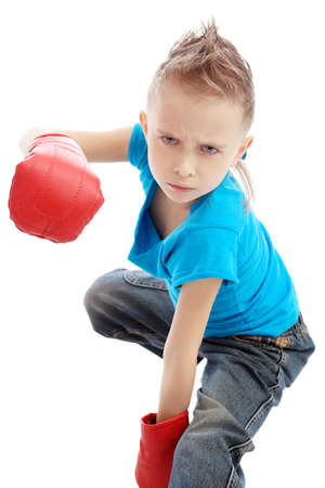 Portrait of a cute sporty boy in boxing gloves. Isolated over white background. Stock Photo - 6386161