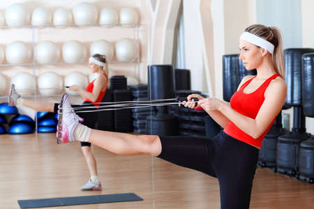 Young sporty woman in the gym centre. Stock Photo - 6386162