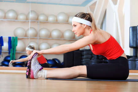 sportsmen: Young sporty woman in the gym centre.