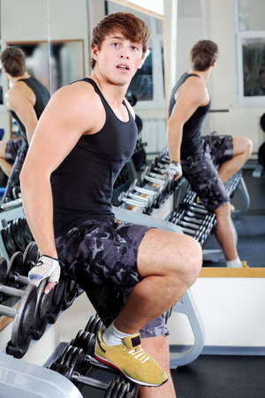 Sporty man in the gym centre. photo