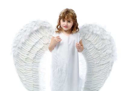 Beautiful little angel isolated over white background. photo
