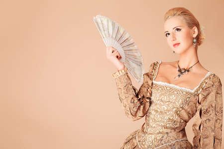 queen's theatre: Portrait of a beautiful woman in medieval era dress. Shot in a studio. Stock Photo