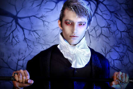 19th century: Portrait of a handsome young man with vampire style make-up. Shot in a studio. Stock Photo