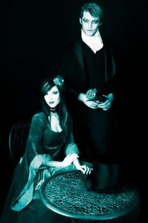 Portrait of a beautiful couple in medieval costumes with vampire style make-up. Shot in a studio. Stock Photo - 6432953
