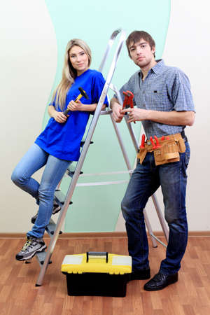 Happy family making repairs at their new home. Stock Photo - 6432955