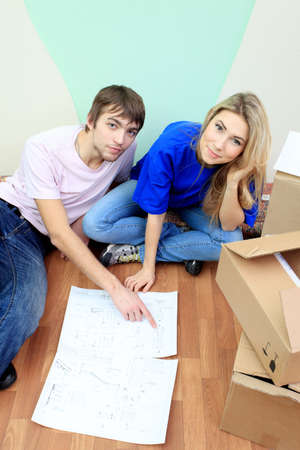 hypothec: Happy family making repairs at their new home.