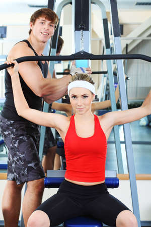 body builder: Couple of a sporty young people in the gym centre. Stock Photo