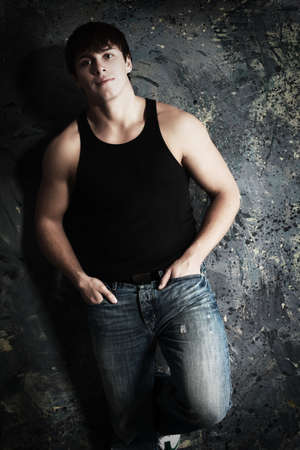 bodybuilding boy: Portrait of a handsome muscular male model.