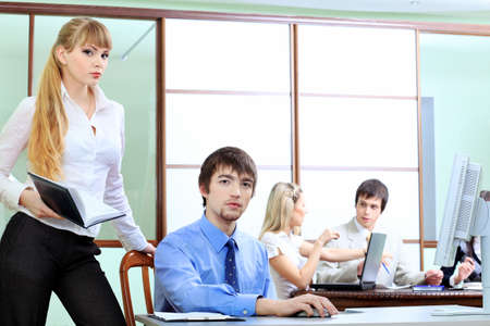 Group of business people interacting together at the office. Stock Photo - 6472962