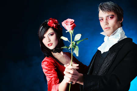 Portrait of a beautiful couple in medieval costumes with vampire style make-up. Shot in a studio. Stock Photo - 6505101