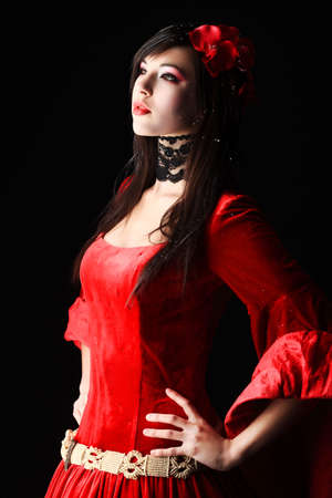 cosplay: Portrait of a beautiful woman in medieval era dress. Shot in a studio. Stock Photo
